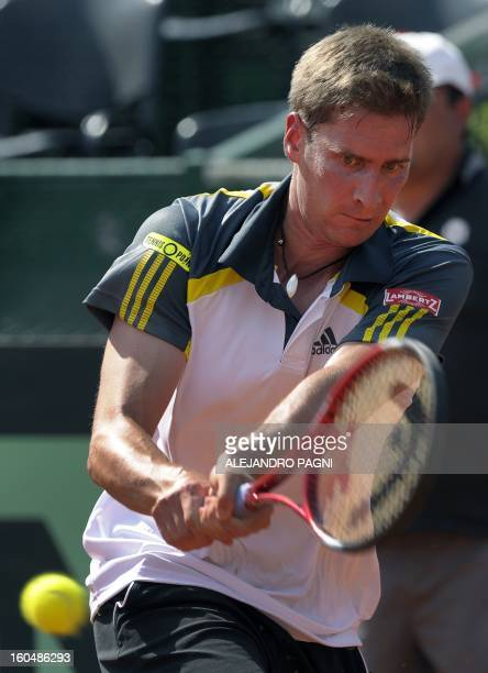 Germany's tennis player Florian Mayer returns the ball to Argentina's Juan Monaco during the 2013 Davis Cup World Group first round single tennis...