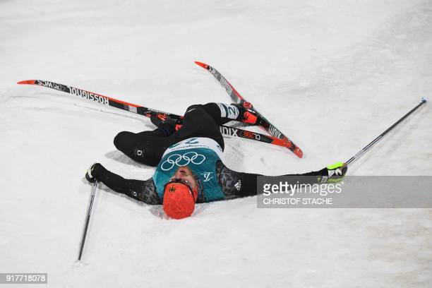 TOPSHOT Germany's Thomas Bing collapses following the men's crosscountry individual sprint classic quarterfinal at the Alpensia cross country ski...