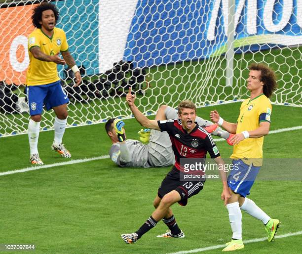 Germany's Thomas Mueller gestures after scoring the 0-1 next to Brazil's David Luiz Marcelo and goal keeper Julio Cesar during the FIFA World Cup...