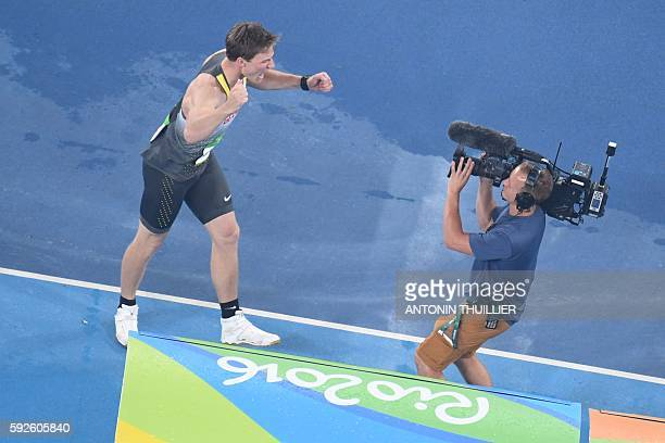 Germany's Thomas Rohler celebrates after he won the Men's Javelin Throw Final during the athletics event at the Rio 2016 Olympic Games at the Olympic...