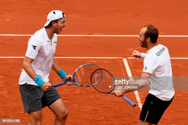 Germany's Tim Puetz and Germany's JanLennard Struff celebrate after beating Spain in the Davis Cup quarterfinal doubles tennis match at the bullring...