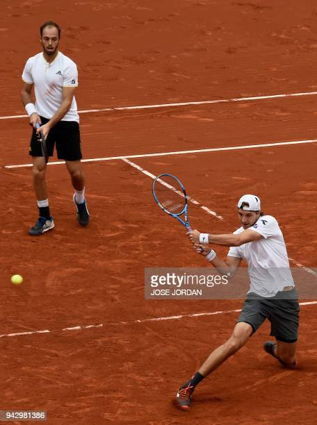 Germany's Tim Puetz and Germany's JanLennard Struff return the ball during the Davis Cup quarterfinal doubles tennis match against Spain's Marc Lopez...