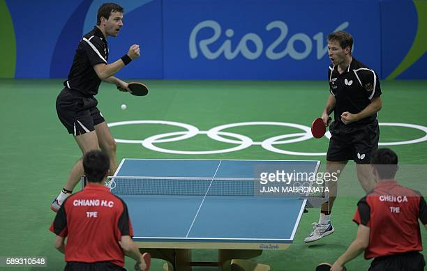 Germany's Timo Boll and Germany's Bastian Steger celebrate a point in the men's team qualification round table tennis match against Taiwan's Chiang...
