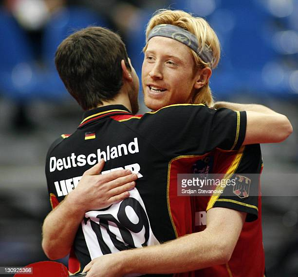 Germany's Timo Bollleft and his partner Christian Suess celebrate after they won the men's double final match against Poland's Lucjan Blaszczyk and...