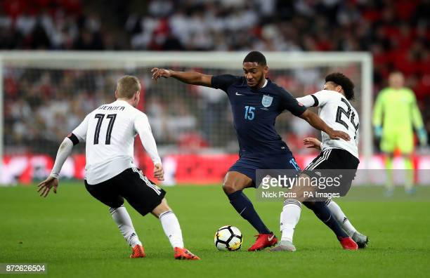 Germany's Timo Werner and Leroy Sane battle for the ball with England's Joe Gomez during the International Friendly match at Wembley Stadium London