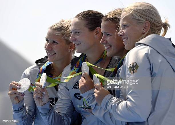 Germany's Tina Dietze Germany's Sabrina Hering Germany's Steffi Kriegerstein and Germany's Franzi Weber celebrate on the podium of the Women's Kayak...