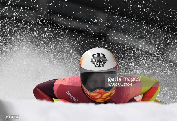 TOPSHOT Germany's Tina Hermann slows down at the end of the women's skeleton heat 2 run during the Pyeongchang 2018 Winter Olympic Games at the...