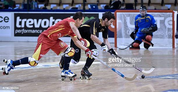 Germany's Tobias Paczia and Spain's Josep Lamas fight for the ball during the semifinal match of the Rink Hockey World championships in la...