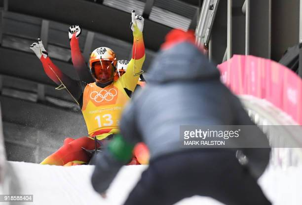 TOPSHOT Germany's Tobias Wendl and Tobias Arlt celebrate the gold in the team relay competition luge final during the Pyeongchang 2018 Winter Olympic...