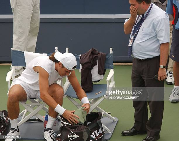 Germany's Tommy Haas is told by an official to change his shirt after it did not meet dress code during the US Open Tennis Tournament 28 August 2002...