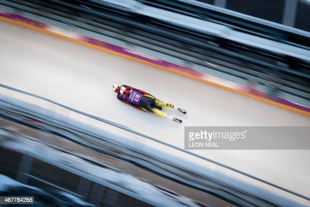 Germany's Toni Eggert and Sascha Benecken race during a Luge Doubles training session at the Sanki Sliding Centre in Rosa Khutor on February 8 during...