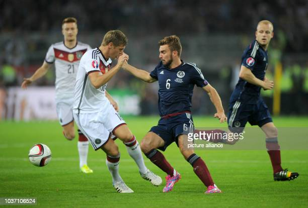 Germany's Toni Kroos and Scotland's James Morrison vvie for the ball during the UEFA EURO 2016 qualifying group D soccer match between Germany and...