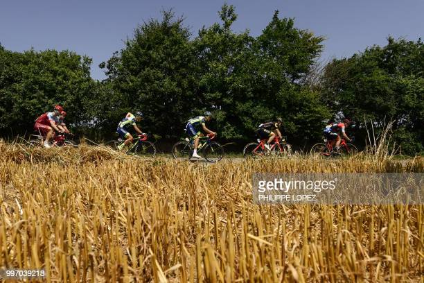 Germany's Tony Martin Belgium's Thomas Degand France's Yoann Offredo France's Thomas Boudat and New Zealand's Patrick Bevin ride in the pack during...