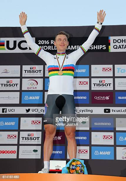 Germany's Tony Martin celebrates on the podium after winning the gold medal at the end of the men's elite individual time trial event as part of the...