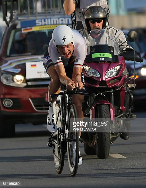 Germany's Tony Martin crosses the finish line during the men's elite individual time trial event as part of the 2016 UCI Road World Championships on...