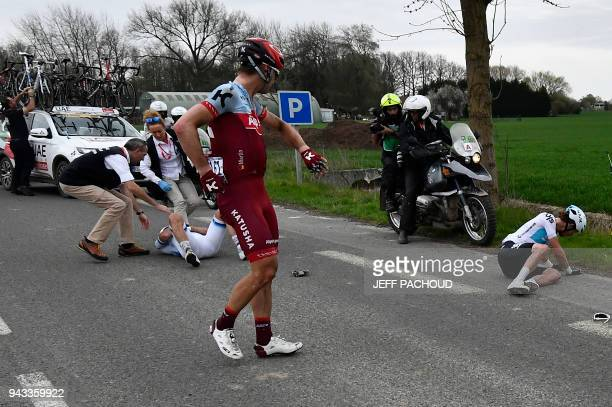 Germany's Tony Martin reacts as Norway's Alexander Kristoff lies on the ground after a crash during the 116th edition of the ParisRoubaix oneday...