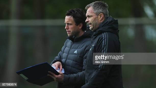 Germany's U16 coach Christian Wueck and his assistant Dennis Lamby watch a match during the U16 Juniors Federal Cup at Sportschule Wedau on May 03...