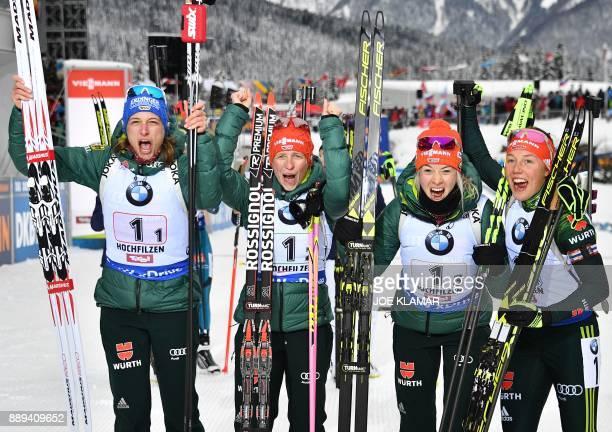 Germany's Vanessa Hinz Franziska Hildebrand Maren Hammerschmidt and Laura Dahlmeier celebrate their victory during the women's 4x6 km relay event at...