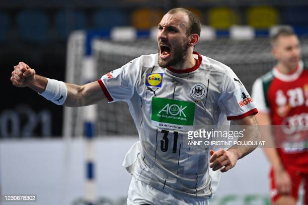 Germany's wing Marcel Schiller celebrates after scoring during the 2021 World Men's Handball Championship match between Group A teams Germany and...