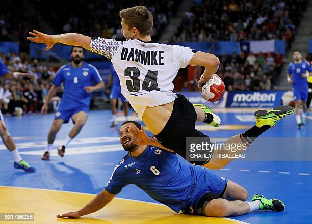 TOPSHOT Germany's wing Rune Dahmke jumps over Chile's wing Pablo Baeza to shoot on goal during the 25th IHF Men's World Championship 2017 Group C...