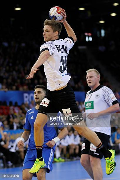 Germany's wing Rune Dahmke jumps to shoot on goal during the 25th IHF Men's World Championship 2017 Group C handball match Chile vs Germany on...