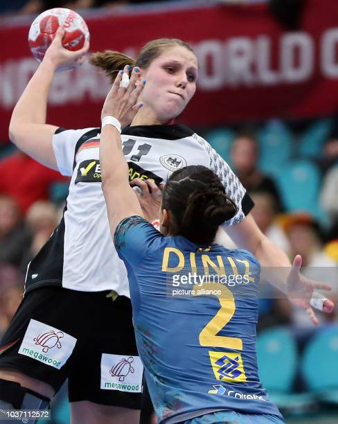 Germany's Xenia Smits and Brazil's Fabiana Diniz in action during the World Women's Handball Championships match between Brazil and Germany in...