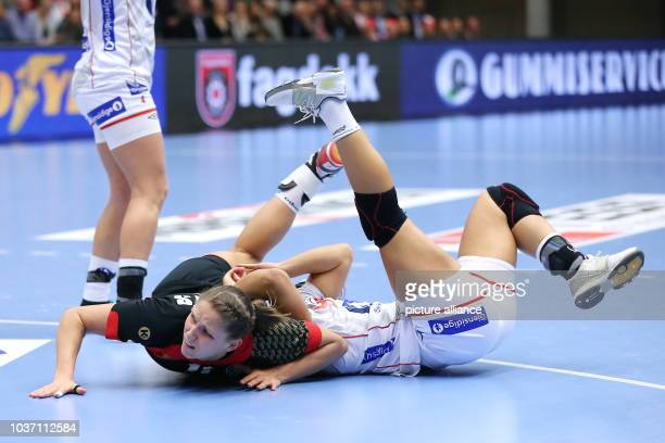 Germany's Xenia Smits and Norway's Heidi Loeke vie for the ball during the World Women's Handball Championship match round of 16 match between...