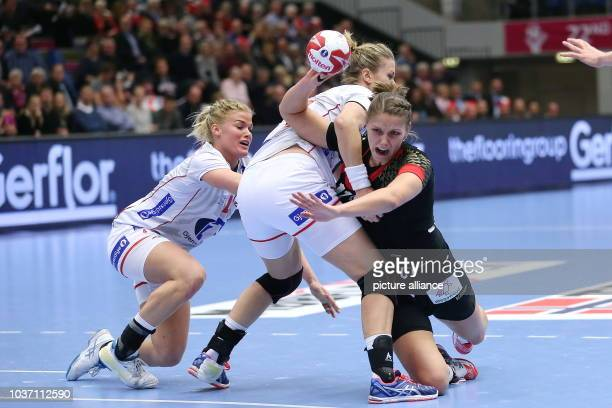 Germany's Xenia Smits and Norway's Pernille Wibe vie for the ball during the World Women's Handball Championship match between Germany and Norway in...