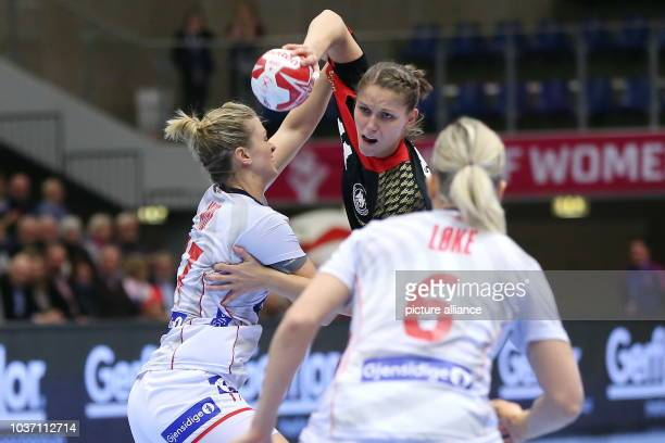 Germany's Xenia Smits and Norways's Heidi Loeke and Pernille Wibe vie for the ball during the World Women's Handball Championship match between...