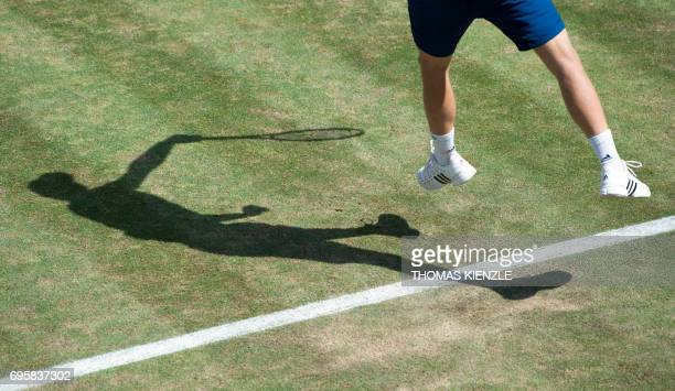 Germany's Yannick Hanfmann serves the ball to fellow countryman Mischa Zverev in their round of sixteen match at the ATP Mercedes Cup tennis...