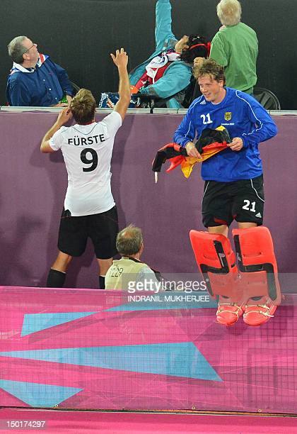 Germany'sMoritz Fuerste and Max Weinhold react after the men's field hockey gold medal match Germany vs the Netherlands at the London 2012 Olympic...