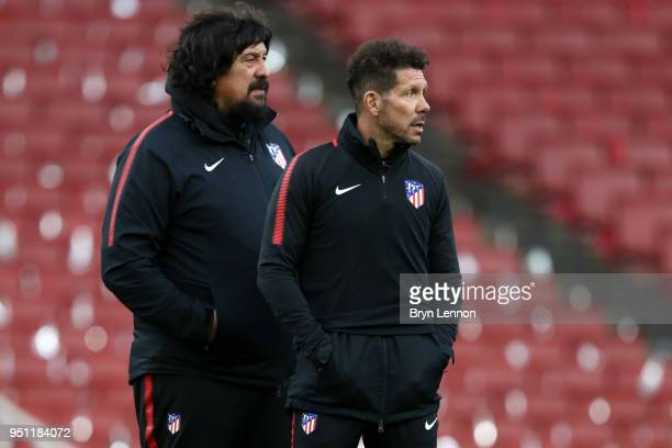 Germán Burgos Assistant manager of Atletico Madrid and Diego Simeone Manager of Atletico Madrid looks on during an Atletico Madrid training session...