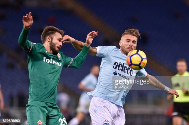 Germn Pezzella of Fiorentina is challenged by Ciro Immobile of Lazio during the Serie A match between Lazio and Fiorentina at Olympic Stadium Roma...