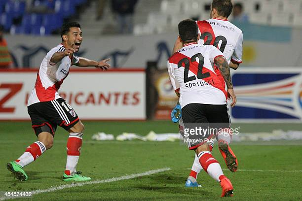 Germán Pezzella of River Plate celebrates with teammates Ariel Rojas and Sebastian Driussi after scoring during a first leg match between Godoy Cruz...