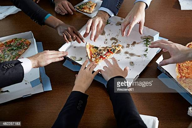 Germnay, Neuss, Hands reaching for pizza