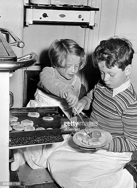 Germny siblings baking biscuits in the fifties