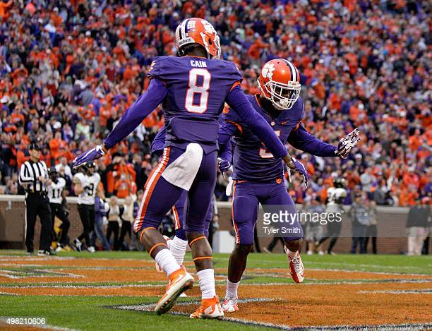 Germone Hopper of the Clemson Tigers reacts with Deon Cain after scoring a touchdown during their game against the Wake Forest Demon Deacons at...