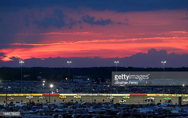 A gerneal view of the action as the suns sets during the NASCAR Sprint Cup Series Bojangles' Southern 500 at Darlington Raceway on May 11 2013 in...