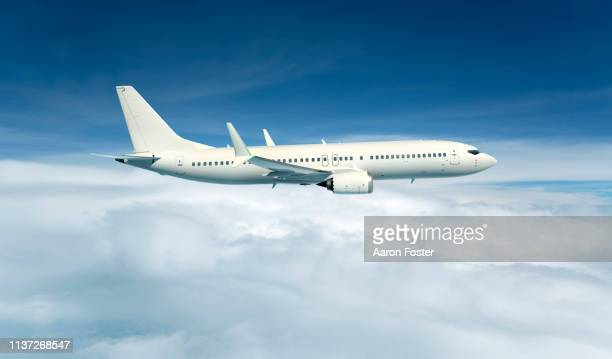 gerneric aircraft in flight - aeroplane stock pictures, royalty-free photos & images