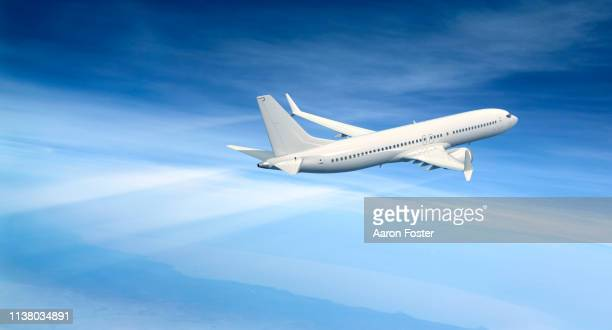 gerneric aircraft in flight - commercial aircraft stock pictures, royalty-free photos & images