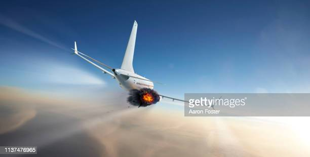 gerneric aircraft in flight with engine failure - airplane crash stock pictures, royalty-free photos & images
