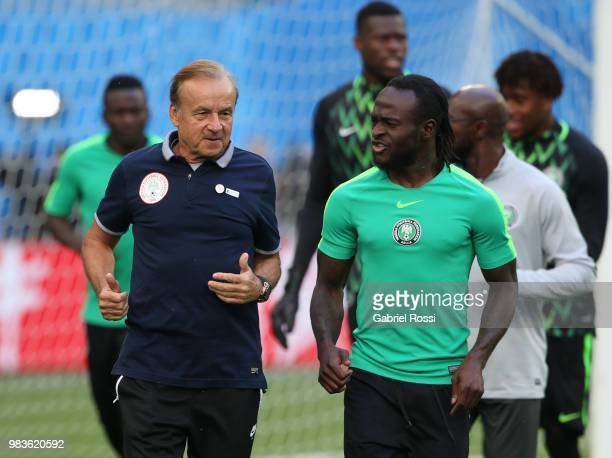 Gernot Rohr coach of Nigeria talk with Victor Moses of Nigeria during Team Nigeria field scouting at Zenit Arena onJune 25 2018 in Saint Petersburg...