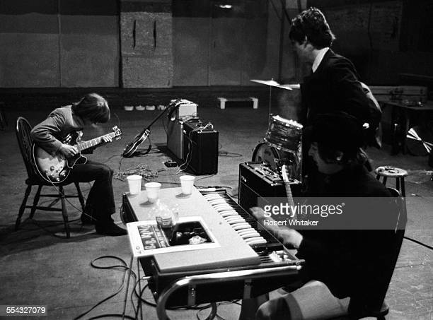 Geroge Harrison Paul McCartney and John Lennon are pictured at the Donmar Rehearsal Theatre in central London during rehearsals for The Beatles...