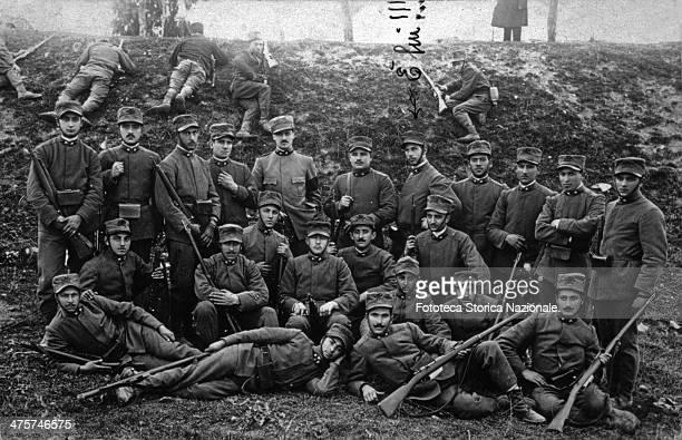 Gerolamo Bartoletti among his brothers in arms in a photogroup to the front poses in a depression Behind the group there are other soldiers remained...