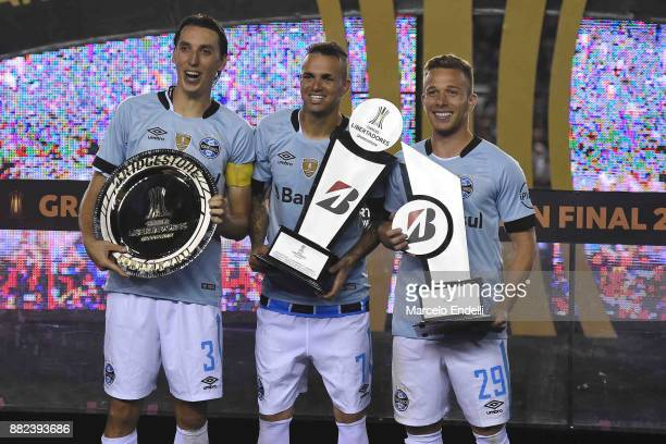 Geromel Luan and Arthur pose with trophies after the second leg match between Lanus and Gremio as part of Copa Bridgestone Libertadores 2017 Final at...