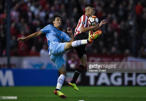 Geromel of Gremio fights for the ball with Francisco Apaolaza of Estudiantes La Plata during a round of sixteen first leg match between Estudiantes...