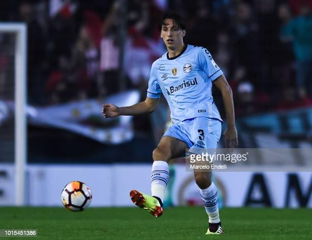 Geromel of Gremio kicks the ball during a round of sixteen first leg match between Estudiantes de La Plata and Gremio as part of Copa CONMEBOL...