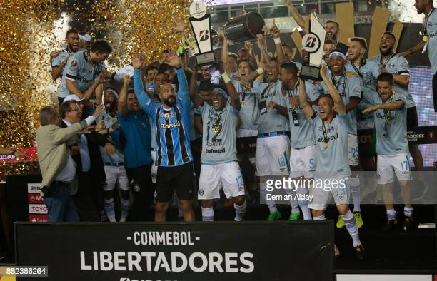 Geromel of Gremio lifts the trophy after winning the second leg match between Lanus and Gremio as part of Copa Bridgestone Libertadores 2017 Final at...