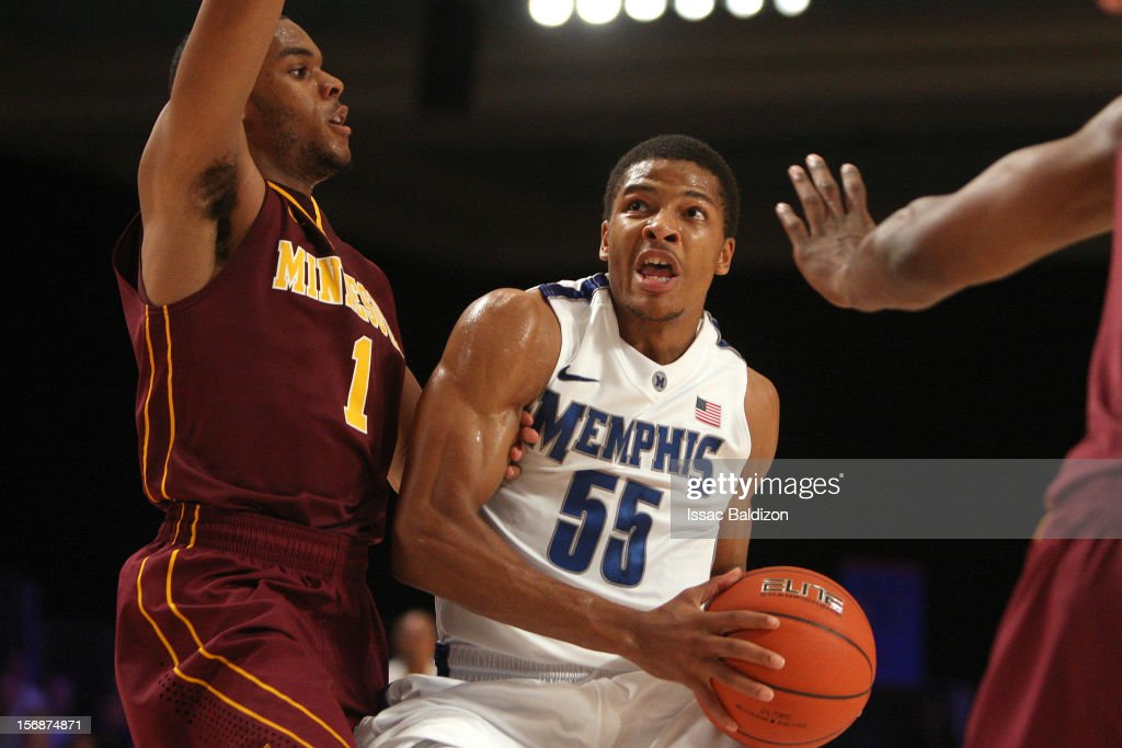 Geron Johnson #55 of the Memphis Tigers drives against Andre Hollins #1 of the Minnesota Gophers during the Battle 4 Atlantis tournament at Atlantis Resort November 23, 2012 in Nassau, Paradise Island, Bahamas.