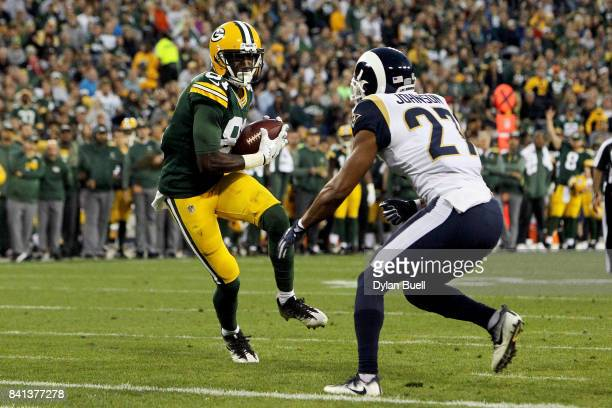 Geronimo Allison of the Green Bay Packers catches a pass in front of Isaiah Johnson of the Los Angeles Rams in the second quarter during a preseason...